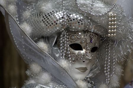 famous women: A woman with a mask in the Venice carnival