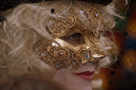 fasching: A woman with a mask in the Venice carnival