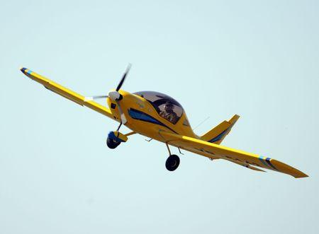 Ultra light yellow airplane  Stock Photo