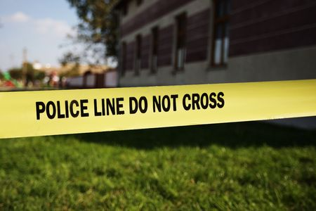Police warning about a crime scene on yellow tape
