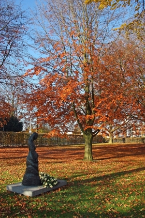 holy mary: bronze statue of Holy Mary and beech tree in Tilburg, Netherlands Stock Photo