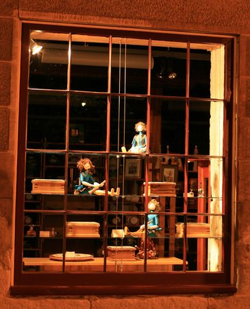 This is the window of an old fashioned toy store taken at night.  photo