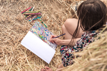 colorful dress: coloring on the hay with bright pencils and colorful dress