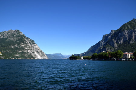 Mediterranean landscape in Italy, Lake Lecco and rocky mountains Stock Photo