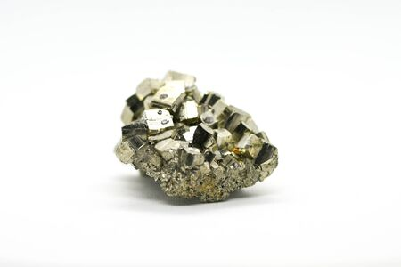 Pyrite crystal against white background Stock Photo
