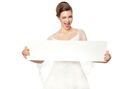 Beautiful smiling bride holding a billboard  photo