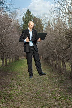 levitating: man holding a laptop and levitates