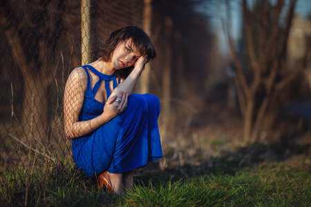 maltreatment: Beautiful girl in evening dress was thrown and suffers  Stock Photo