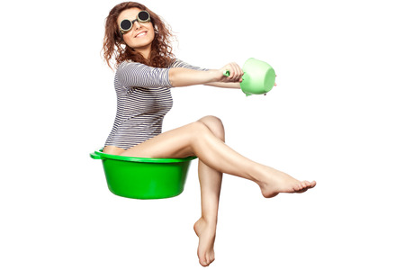 drollery: Funny girl sitting in a green wash rides on a white background