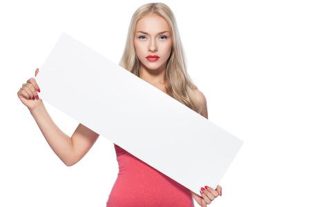 Blonde girl shows poster  On plokate can do advertising inscription  photo
