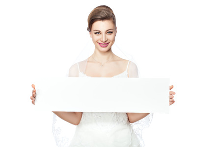 Bride in a veil holding a poster