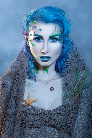 Beautiful glamor girl portrait in marine style  photo