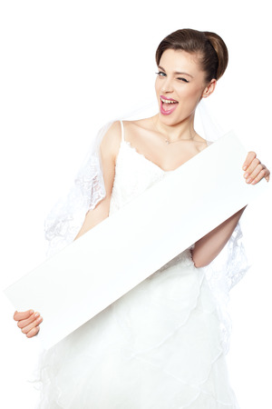 Joyful and happy bride shows a blank poster on which to make an inscription