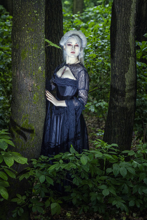 Beautiful fairy girl with white skin alone in the woods