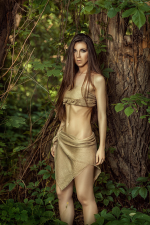 Savage woman with long hair in the forest