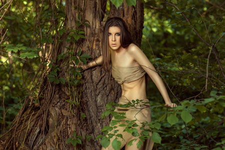 neanderthal women: Savage woman with long hair, looking wary