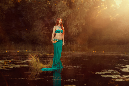 water nymph: Fabulous girl of the river with a ship in the hands  Stock Photo