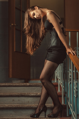 Girl standing on the steps of dissolving the long hair  Stock Photo
