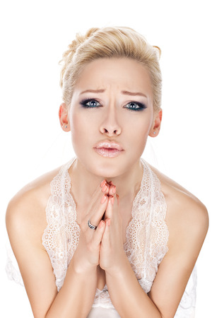 fantastical: Bride girl crying and praying before the wedding  Stock Photo