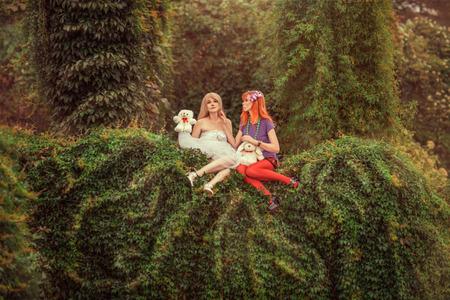 Fabulous two girls like dolls in the garden