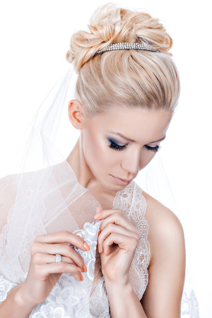 Girl bride with wedding hairstyle and tiara. photo