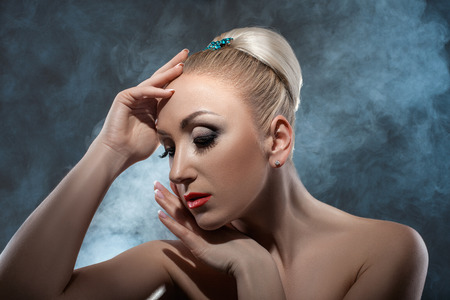 frippery: Stylish girl with hairstyle and jewelery on dark . Stock Photo