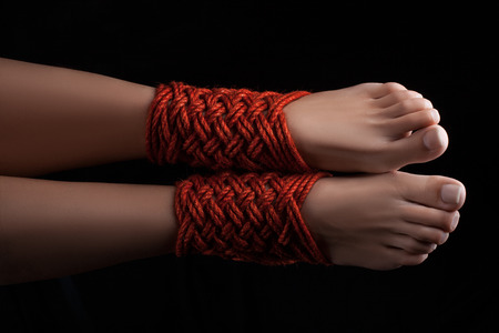 Shibari pattern on two legs female closeup. Stock Photo