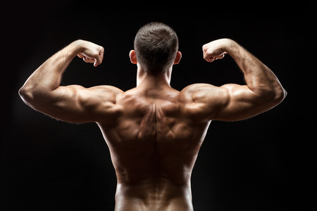 snappy: The man is standing back and showing big muscles on his back, he Stock Photo