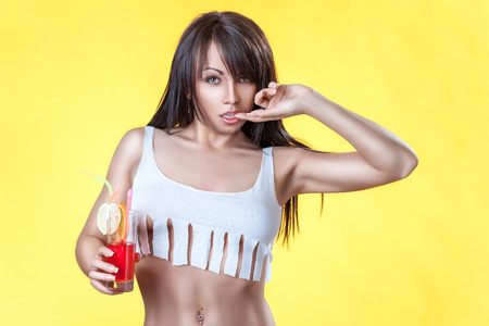 colleen: Girl with a cocktail in the form of a T-shirt ads on yellow bright background.