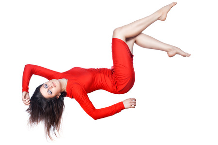 hovering: Happy girl in a red dress falls, she arranged the arms and legs, on white background. Stock Photo