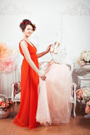 tenderly: Girl touching tenderly pink ballet dress, hanging near pointe.