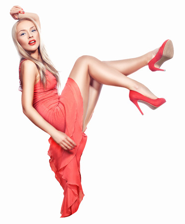 coral colored: Blonde girl in a dress and shoes coral color drops on a white background.