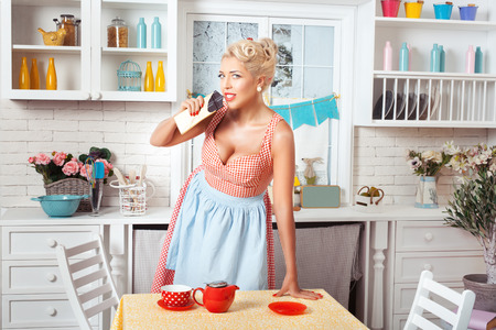footsie: Woman is standing in the kitchen and wants to eat chocolate candy. She is in a retro style.