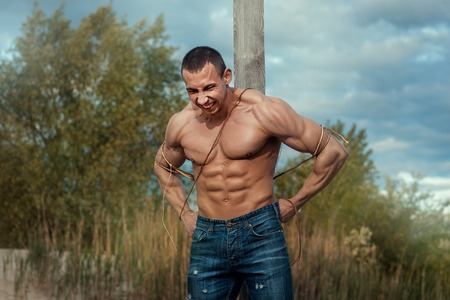 manful: Man with large muscles attached to the pillar. He tries to break free.