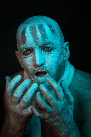 frenetic: Portrait of frozen man. He is bald and scary. Stock Photo