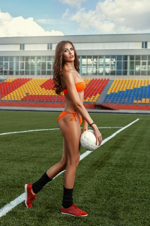 agility people: On the football field is a girl. In the hands of the ball.