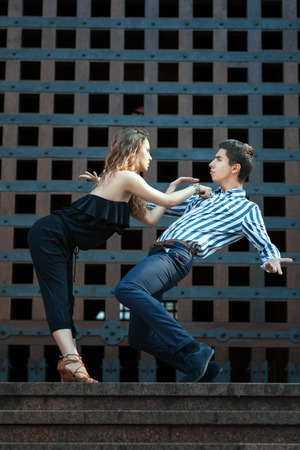 Young couple dancing the tango. They play emotions. See more photos of this series.