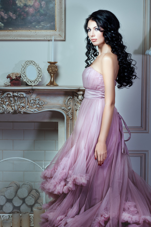 sumptuousness: Girl in a magnificent pink dress. She has long black hair and a gentle make-up on her face.