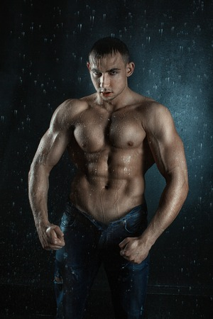aqua naked: Terrible men look wet from the water.  Water flows on its embossed muscular body.