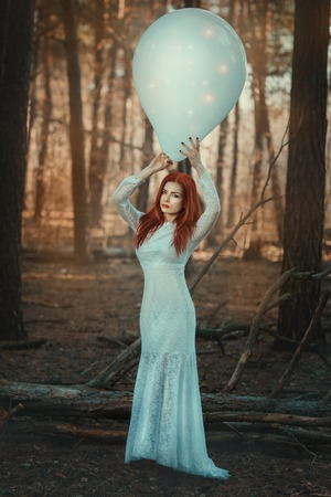 mage: Woman in fairy forest with a huge inflatable ball.