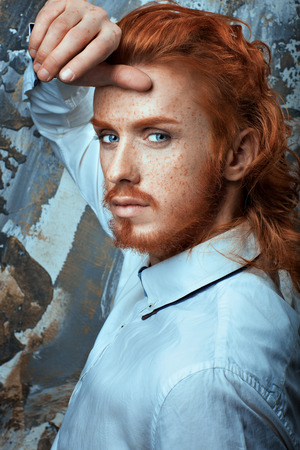 attractiveness: Red-haired man with a beard and mustache in a white shirt metrosexual.