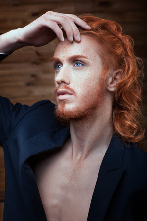 metrosexual: Portrait of a Man with red hair, he is metrosexual. Stock Photo