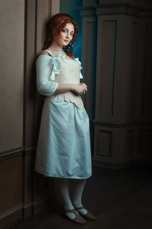 domestics: Woman dressed in Renaissance style as a maid.
