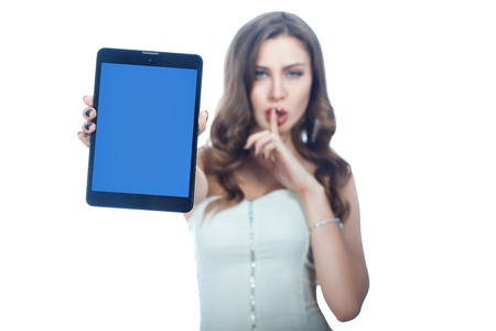 put forward: Girl put arm forward with a tablet computer. The plate is in focus and blurred girl.