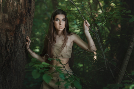uncouth: European woman lives in the woods like a savage.