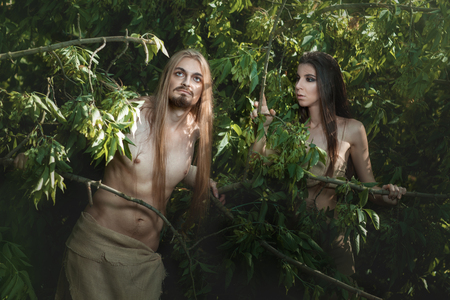 neanderthal women: European couple lives in the woods like wild people. Stock Photo