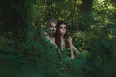 neanderthal women: The young couple went to live in the forest and far away from the problems. Stock Photo