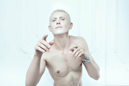 womanlike: Portrait of a male albino with white skin. Stock Photo