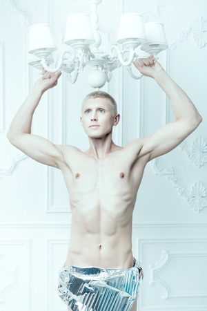 womanlike: Male albino with a beautiful figure, his white skin. Stock Photo