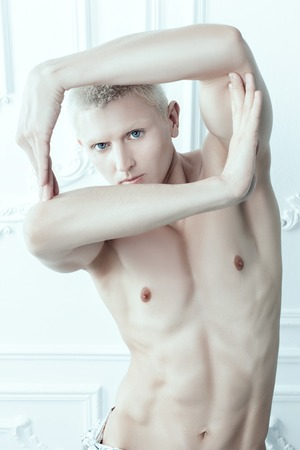 womanlike: Male albino makes shapes with his hands.